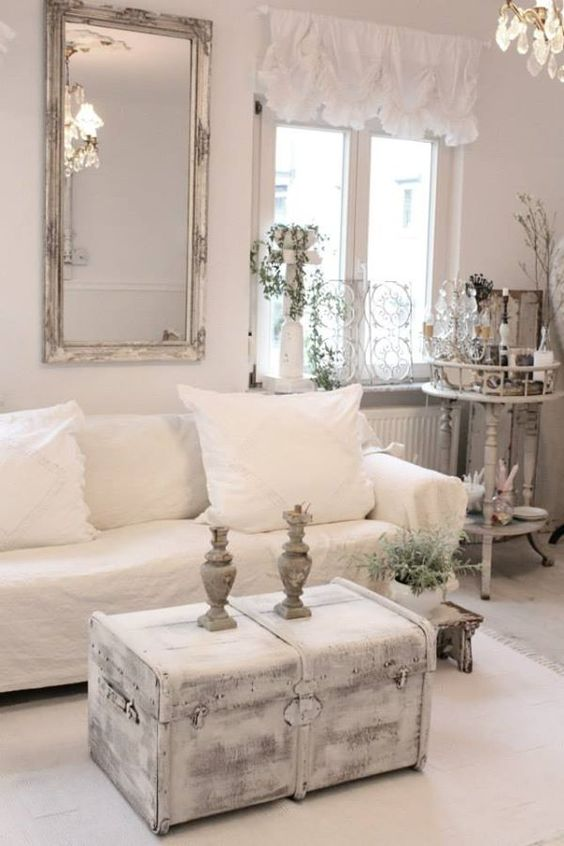 shabby chic whitewashed chest and a framed mirror