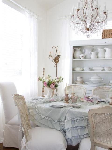 a crystal chandelier and a serenity ruffled tablecloth create an ambience