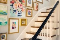 24 mismatched gold frames with bold paintings