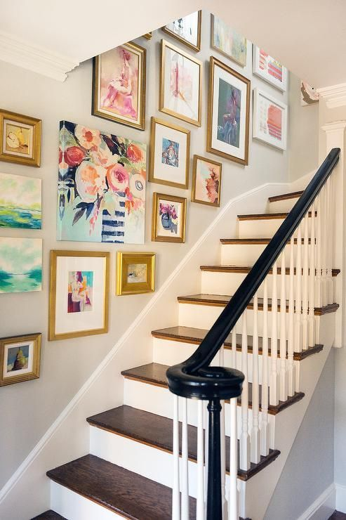 mismatched gold frames with bold paintings