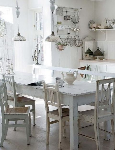 shabby dining table and chairs in the white kitchen