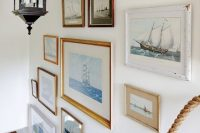 26 gilded and white frames with sea artwork