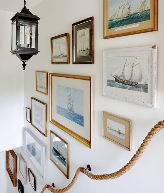 gilded and white frames with sea artwork