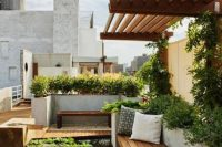 26 rooftop row garden with a wooden deck