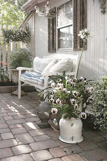 lots of potted flowers create an ambience