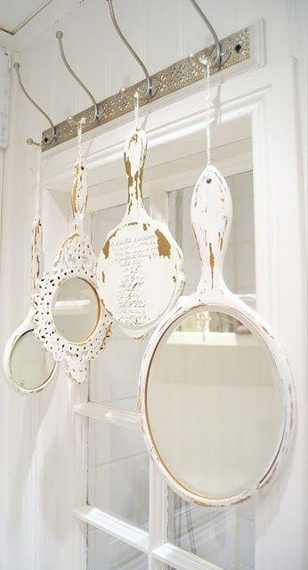 white shabby hand mirrors display