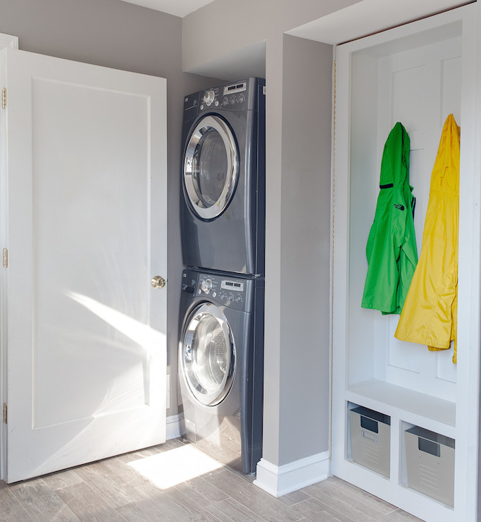stacked washer and dryer in a mudroom laundry