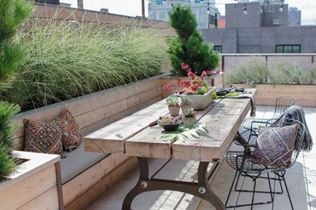 tiny urban rooftop garden with planters