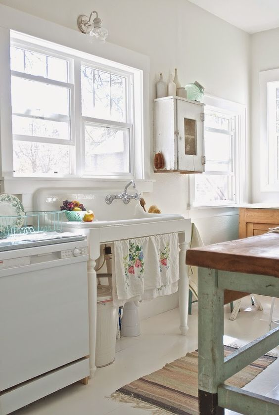 white kitchen cabinet and a white sink stand in shabby chic style