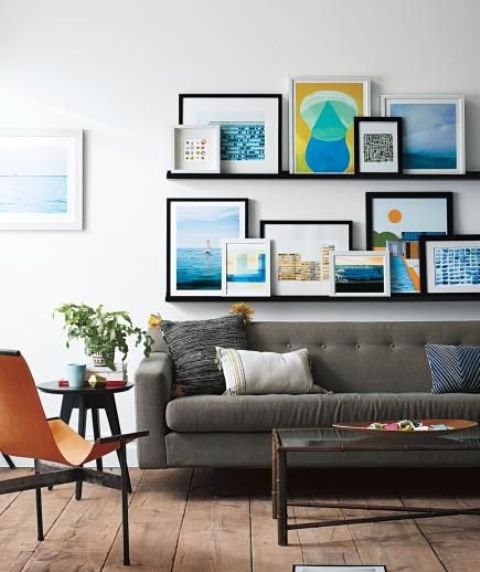 black gallery wall with colorful artworks