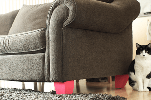 DIY bold legs for a sofa (via shelterness)