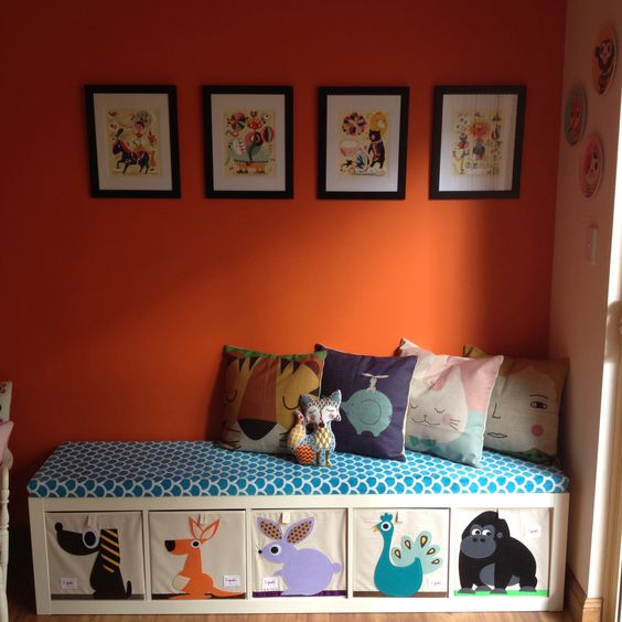 Ikea Expedit playroom bench made of fabric stuffed with foam and sprouts storage cubes (via https:)