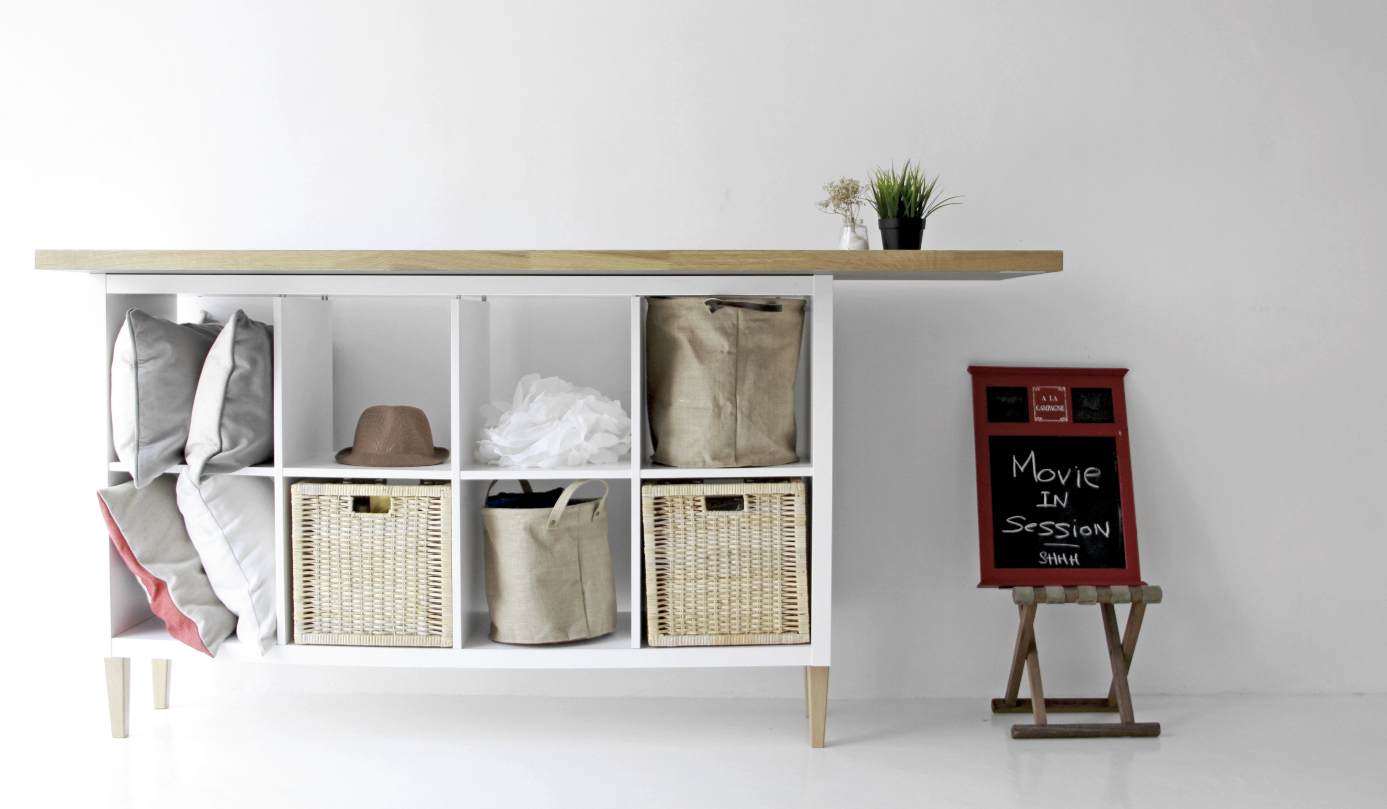 Kallax sideboard hack with IKEA sofa legs and wooden tabletop