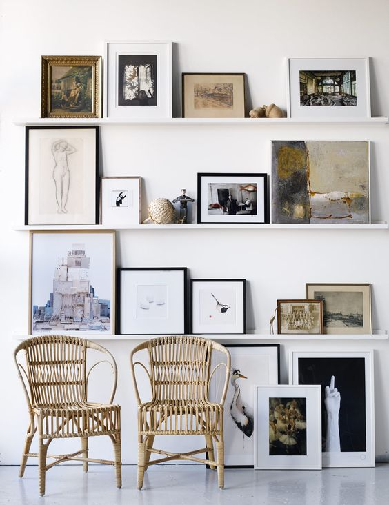 white ledge gallery with various frames