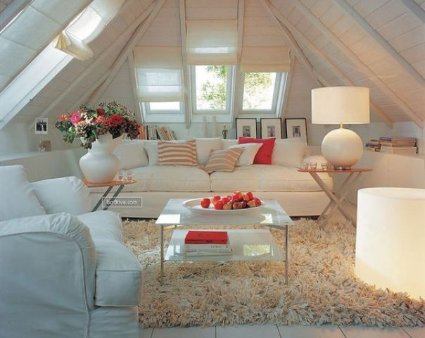 all white attic living room with red touches