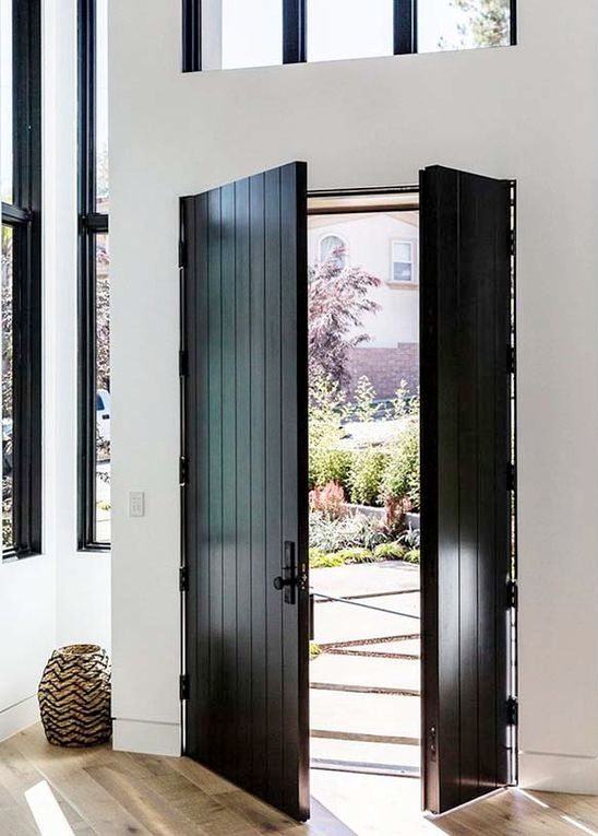 black cottage-style wooden plank front doors & 27 Chic Dark Front Doors To Try For Your Entry - Shelterness