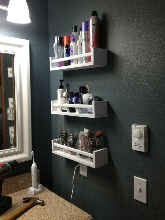 Awesome open bathroom shelves from IKEA pieces next to the mirror