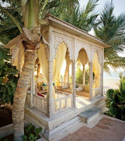 Moroccan-nspired pool cabana with draperies to cover it