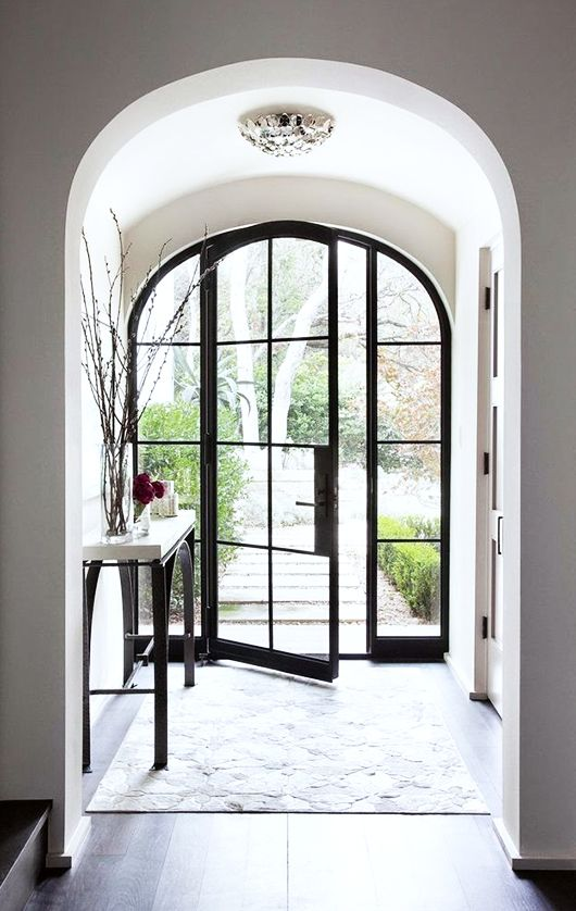 picture of arched glass and steel front door