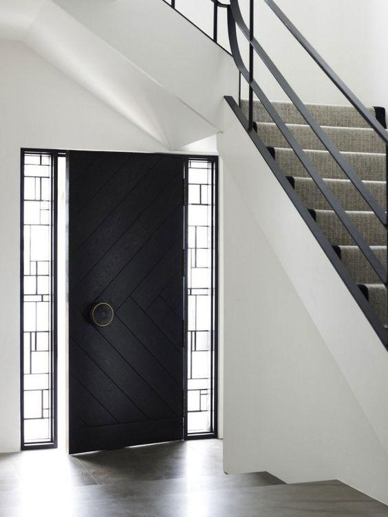 herringbone front door with geo sidelights