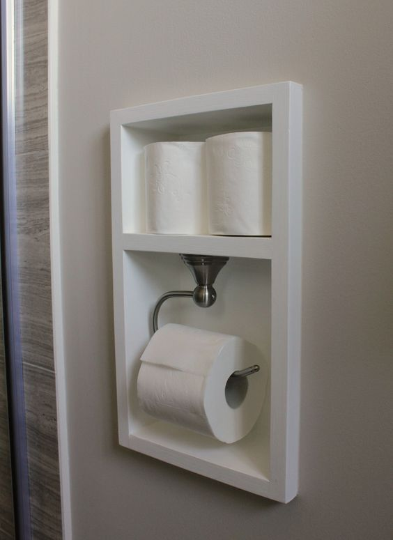 Beautiful built in recessed toilet paper holder with extra roll storage