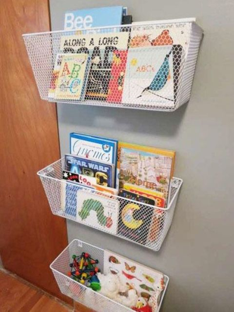 metal cubbies attached to the wall are great for books and magazines storage