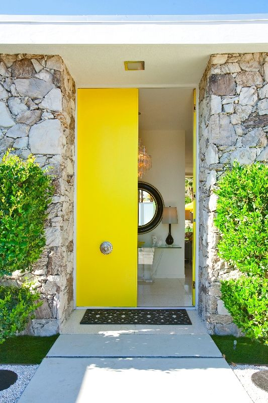 narrow yellow doors with antique handles