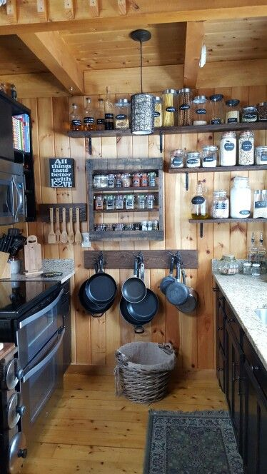 open wooden shelves and lots of hooks