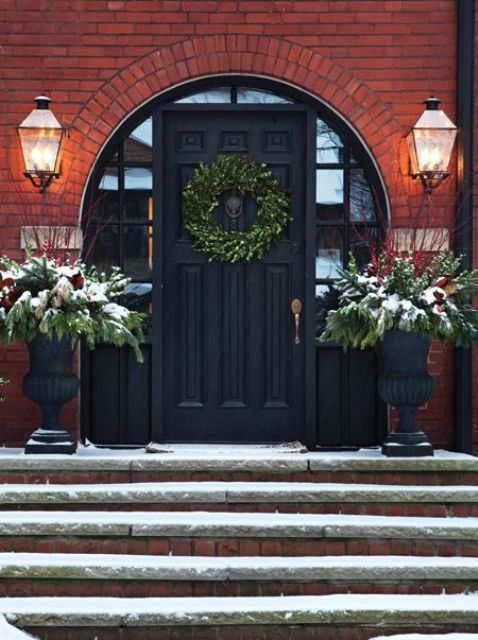 black front door with a round arch and sidelights