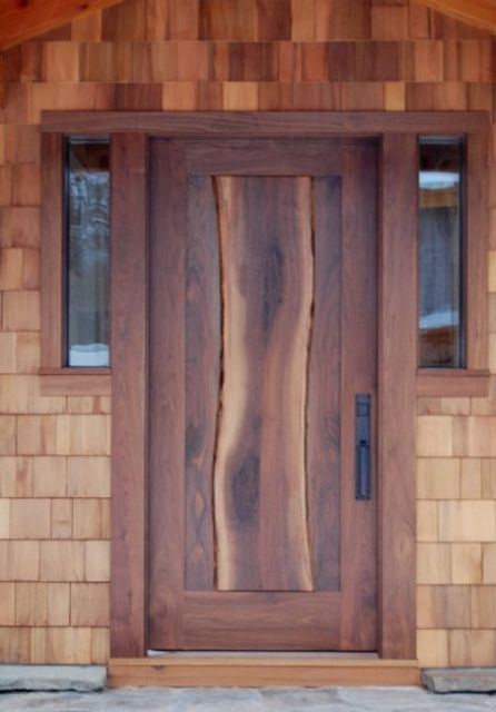 entry door with thick walnut slab flowing down the center