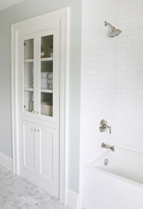 Fancy in wall bathroom storage cabinet next to the bathtub