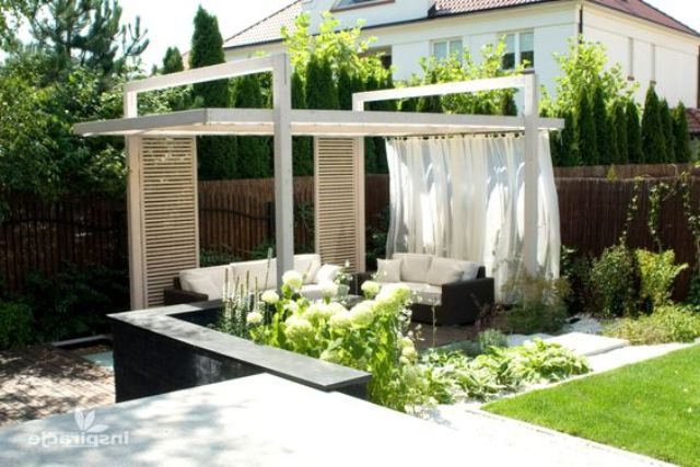 all-white gazebo with suscreens and curtains on one side