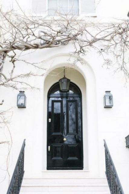 black lacquered front door with a white frame