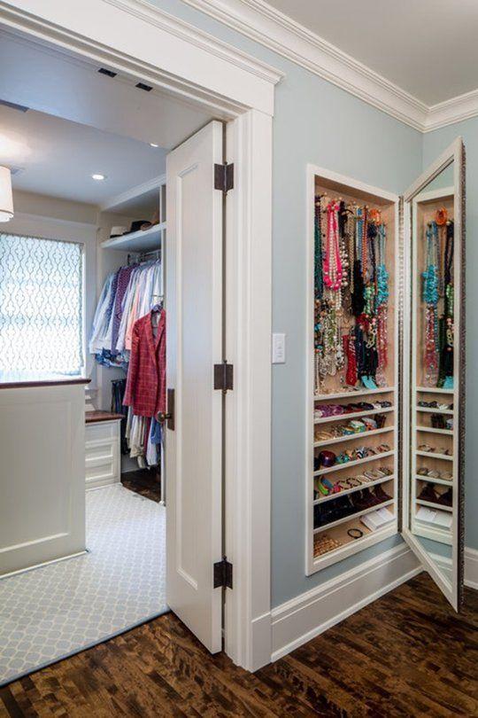 built-in jewelry storage with a mirror door