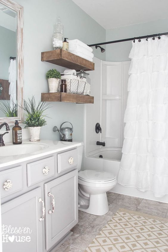 open rustic shelves next to the bathtub