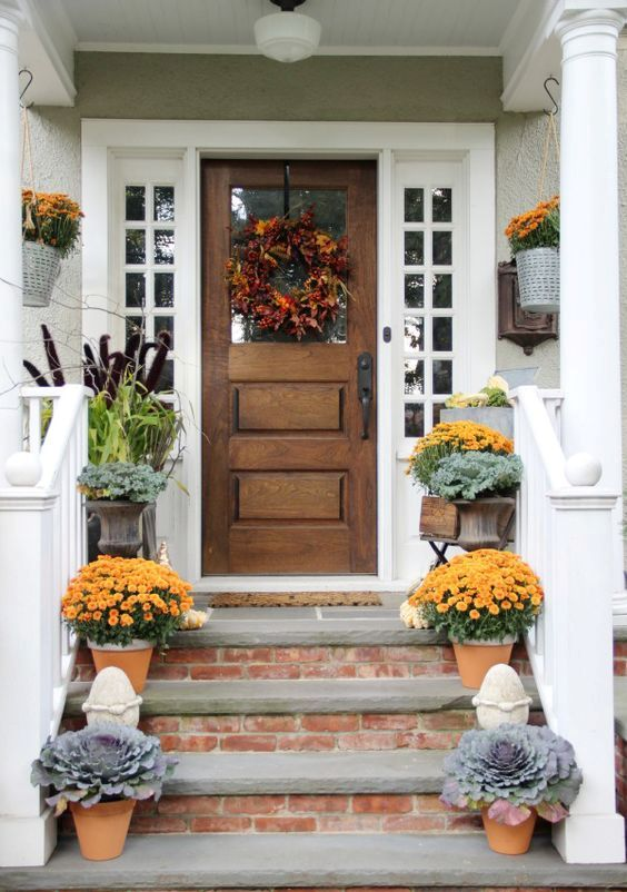 vintage wooden front door with white sidelights