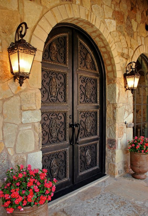 dark vintage-styled wrought iron front doors