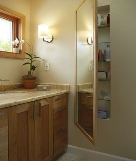 in-wall medicine cabinet hidden behind a mirror