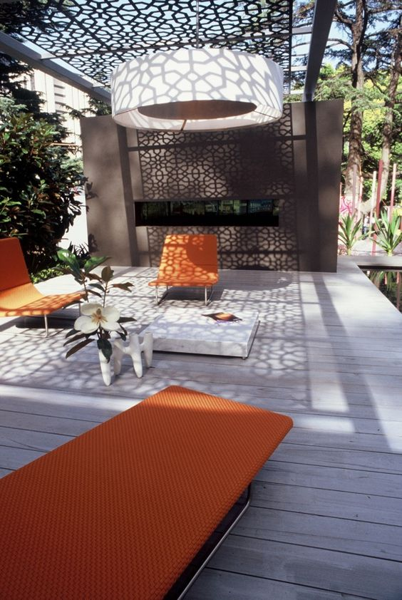 modern bold pergola with laser cut metal screens to protect from the sun