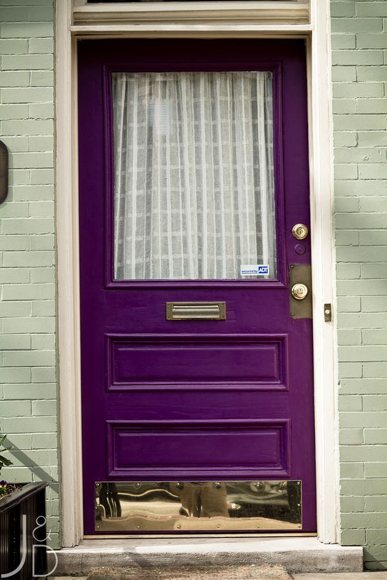purple front door with gold appliques