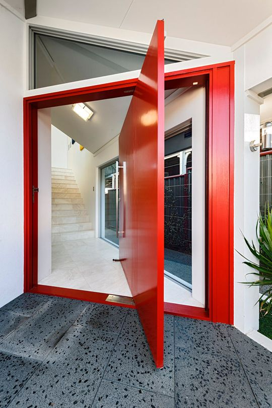 bold red oversized pivot door