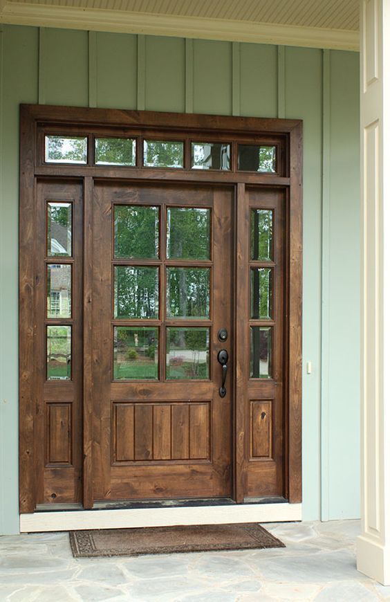 dark stained wooden door with sidelights