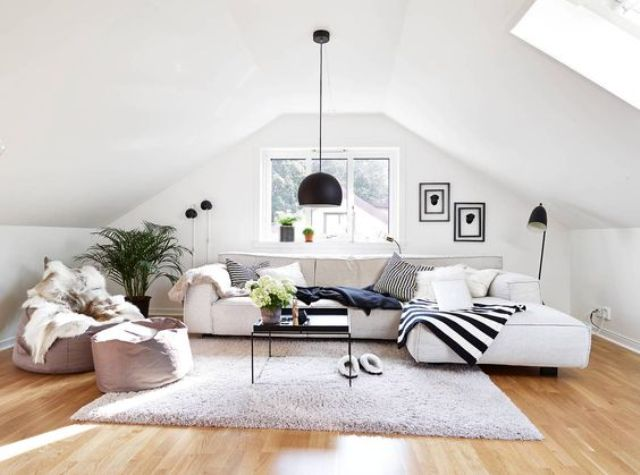 modern monochromatic attic living room