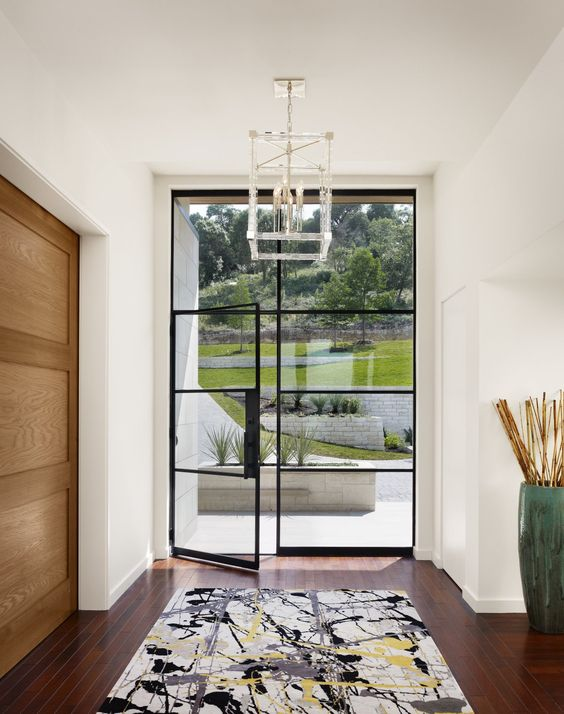 oversized blackened steel frame glass door