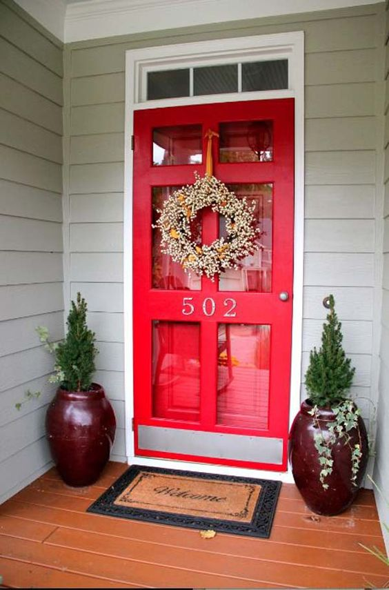 red glass door with burgundy containers