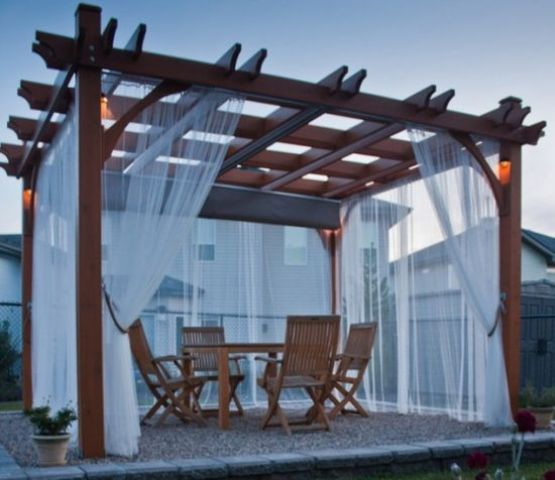 wooden gazebo covered with light draperies