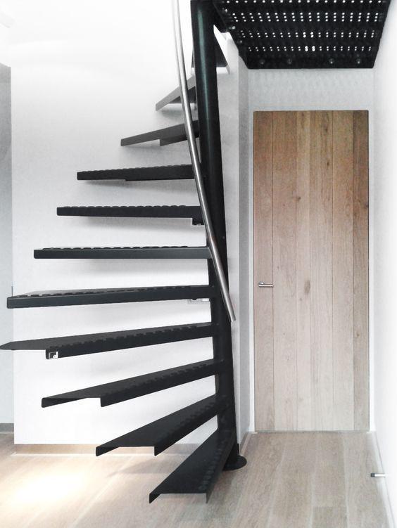 blackened metal swirl staircase
