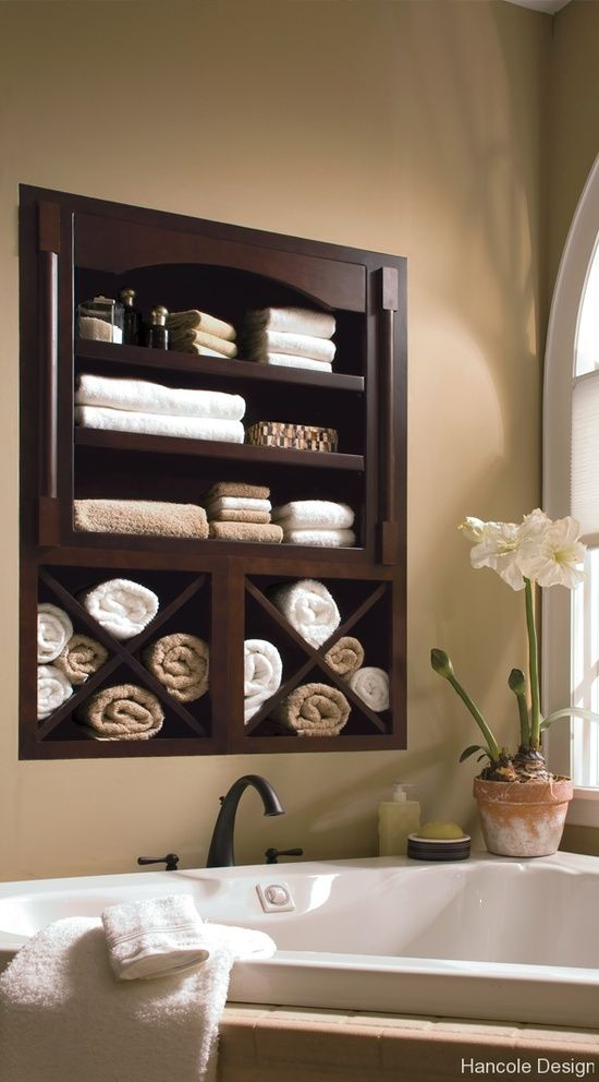 in-wall towel storage to keep the bathroom clean