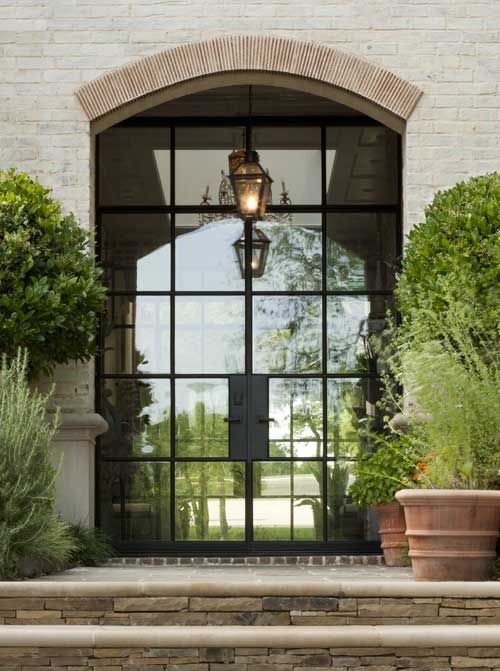 oversized metal and glass front doors