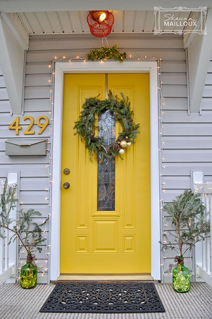 sunny yellow front door with a narrow pane